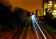 Stock Photo of Long exposure trains heading toward camera