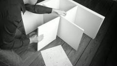 Constructing Self-Assembly Furniture - stock footage