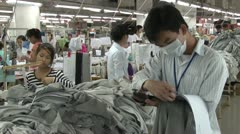 Textile Clothing Factory: Medium shot supervisors with clipboard and worker Stock Footage