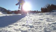 Snowboarder jumping over the camera Stock Footage