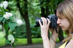 photographing flower - stock photo