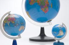 Three earth globes Stock Photos
