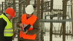 Engineer sign contracts at the electrical substation Stock Footage