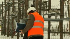 Two engineers at the electrical substation Stock Footage