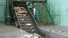 Wastepaper at recycling plant Stock Footage