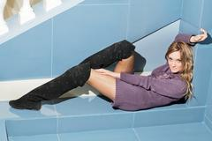 Pretty young woman lying - stock photo