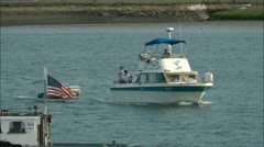 Boat tows dinghy on river Stock Footage