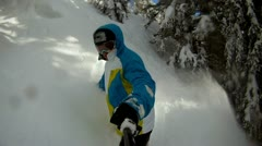 Snowboarder riding fresh snow - stock footage