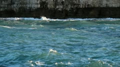 Waves and fisherman Stock Footage