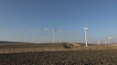 Wind turbines in meadows Stock Footage