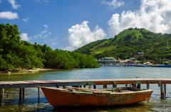 Old Boat and Tropical Island - stock photo