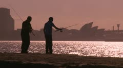 Silhouette of fishermen & Sydney, red tint Stock Footage