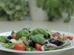 Plate with fresh vegetable salad NTSC Stock Footage