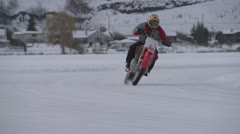 Motorsports, slo-mo (240fps) ice bike race corner through frame tight x3 Stock Footage