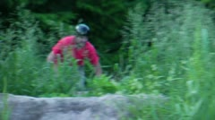 Bmx rider barspin at dirt jumps Stock Footage