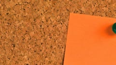 Postit note paper on a cork bulletin board Stock Footage