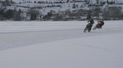 Motorsports, bike ice race inside corner follow tight shot Stock Footage
