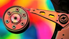 Hard drive platter colorized showing read write head Stock Footage