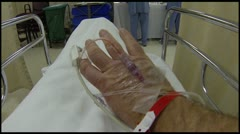 Intravenous therapy male hand in hospital bed HD 016 Stock Footage
