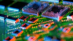 Assorted integrated circuits on printed circuit background Stock Footage