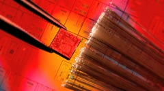 Silicon ic chip with wafer background and fiber optics Stock Footage