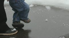Baby feet trying to step but slipping on the ice - stock footage