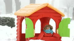 Little baby playing in a colorful house Stock Footage