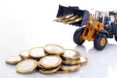 coins and loader - stock photo