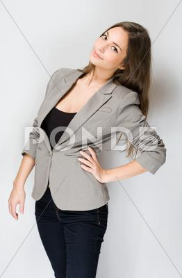 Stock photo of fashionable young brunette woman.