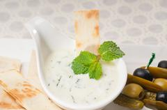 greek tzatziki yogurt dip and pita bread - stock photo