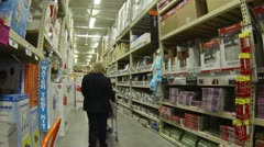 Woman shops in hardware department store HD 016 - stock footage