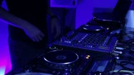 Tripod shot of performing DJ, scratching turntables Stock Footage