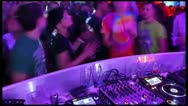 Timelapse of people walking near the dj zone in night club Stock Footage