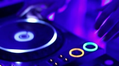 Hands of DJ take disks from the deck during performance in night club - stock footage