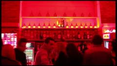 Timelapse of people walking near the bar in night club - stock footage