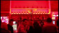 Timelapse of people walking near the bar in night club Stock Footage