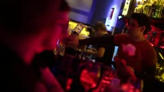 Bartenders in night club bar are serving drinks for visitors Stock Footage