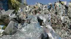 Stack of plastic bottles and plastic bags at recycling plant. Stock Footage