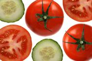 Stock Photo of tomatoes and cucumbers on white background