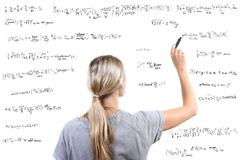 woman writing mathematical equations - stock photo