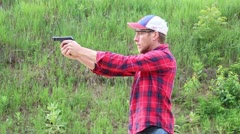 Hand gun being fired off Stock Footage