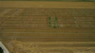 Stock Video Footage of AERIAL: Tractor working on a field