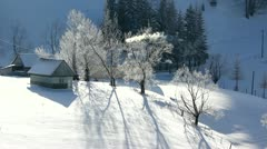 Shadows of house and trees on the snow Stock Footage