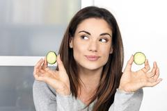 Stock Photo of woman with a slice of cucumber