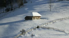 Isolated wooden shed in winter scenery Stock Footage