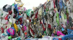 Stack of plastic waste sorted in cubes at recycling plant Stock Footage