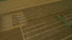 AERIAL: Tractor working on a field Stock Footage