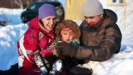 Stock Video Footage of Portrait of a happy couple with a child in winter