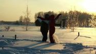 Stock Video Footage of Young couple go to meet each other through the snowdrifts
