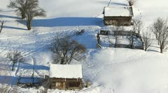 Two wooden houses in a isolated village covered with snow Stock Footage